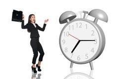Business woman frightened big gray alarm clock Stock Photography