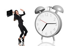 Business woman frightened big gray alarm clock Royalty Free Stock Photography