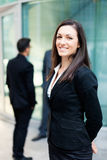 Business woman in front of her colleagues Stock Photo