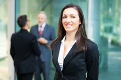 Business woman in front of her colleagues Royalty Free Stock Image