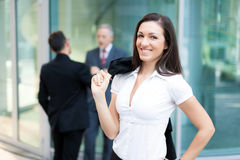 Business woman in front of her colleagues Royalty Free Stock Images