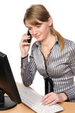 Business woman in front of her desktop computer Royalty Free Stock Photos