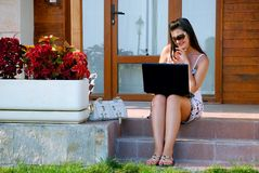 Business woman in front of her veranda 5 royalty free stock photos