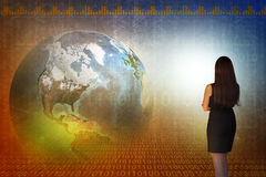 Business woman in front of holographic screen Stock Photos