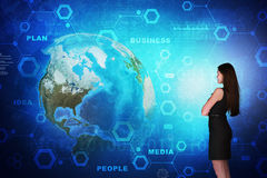 Business woman in front of holographic screen Stock Photo