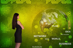 Business woman in front of holographic screen royalty free stock image