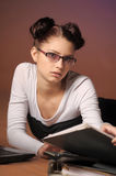 Business woman in front of a laptop with folders of papers Royalty Free Stock Photo