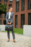 Business woman in front of office building Stock Image