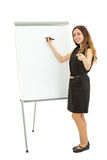 Business woman in front of a white board pointing towards the ca Royalty Free Stock Photo