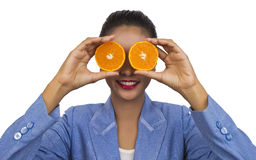 Business woman with fruits (an orange). Royalty Free Stock Images