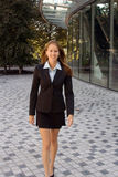 Business Woman - Full Body - Confident - Success. A successful business woman is approaching royalty free stock photography