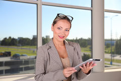 Business woman with gadget Royalty Free Stock Images
