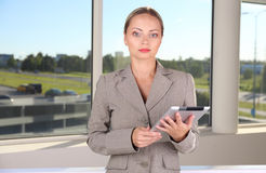 Business woman with gadget Royalty Free Stock Image