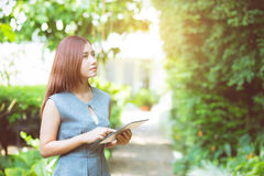 Business woman in the garden looking tablet. Business woman in the garden looking tablet - happy and smiling Stock Photos