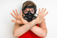 Business woman with gas mask is showing negative gesture Stock Images