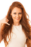 Business woman gesturing call me sign with her hand isolated ove Stock Photography