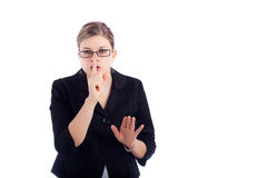 Business woman gesturing silence sign. Young business woman gesturing silence sign, isolated on white background Royalty Free Stock Images