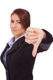 Business woman gesturing thumbs down. Young business woman gesturing thumbs down over white Stock Photo