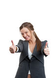 Business woman gesturing a thumbs up sign Stock Photos