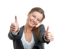 Business woman gesturing a thumbs up sign. Portrait of a young businesswoman gesturing a thumbs up sign isolated over white Stock Images