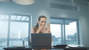 Business woman getting message at mobile phone. Smiling person having break. Business woman getting message at mobile phone at remote work place. Smiling female stock video footage