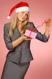 Business-woman & gift. The girl with New Year's  gift Stock Photography