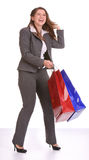 Business woman with gift bag. Laughing business woman with gift bag Royalty Free Stock Photo