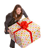 Business woman with gift box. Smile business woman with big gift box. Isolated Stock Images