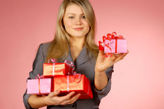 Business-woman & gifts. The girl with New Year's  gifts Royalty Free Stock Photos