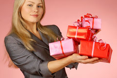 Business-woman & gifts. The girl with New Year's  gifts Royalty Free Stock Image