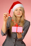 Business-woman & gifts. The girl with New Year's  gifts Stock Images