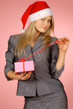 Business-woman & gifts. The girl with New Year's  gifts Royalty Free Stock Images