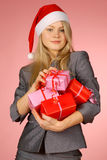 Business-woman & gifts. The girl with New Year's  gifts Royalty Free Stock Photography