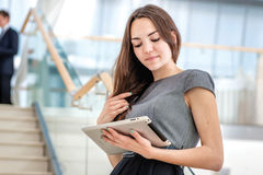 Business woman girl holding a tablet Royalty Free Stock Photos