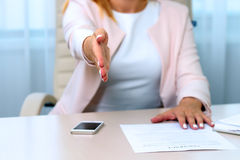 Business woman gives a handshake Royalty Free Stock Images