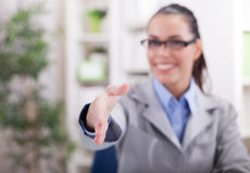 Business woman gives a handshake Stock Images