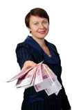 The business woman gives money. On white background Royalty Free Stock Image