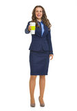 Business woman giving cup of hot beverage Royalty Free Stock Photo