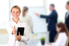Business woman giving a handshake, business people on a backgr Stock Photo