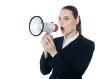 Business woman giving instructions with megaphone. Isolated over white Royalty Free Stock Images