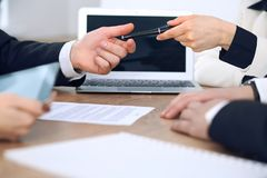 Business woman giving pen to businessman ready to sign contract. Success communication at meeting or negotiation Stock Photography