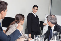 Business woman giving presentation Stock Photo