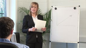Business Woman Giving A presentation. Stock Video Footage of a Business Woman Standing and Giving a Presentation stock footage