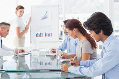 Business woman giving a presentation Royalty Free Stock Images