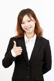 Business woman giving thumb up Royalty Free Stock Photo