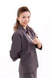 Business woman giving thumb up Stock Photo