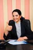 Business woman giving thumbs Royalty Free Stock Image