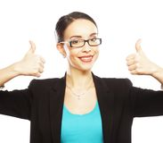 Business woman giving thumbs up Stock Photo