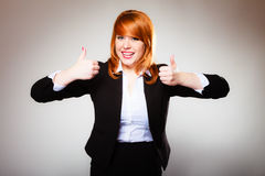 Business woman giving thumbs up sign Royalty Free Stock Image