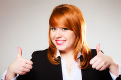 Business woman giving thumbs up sign Royalty Free Stock Photo